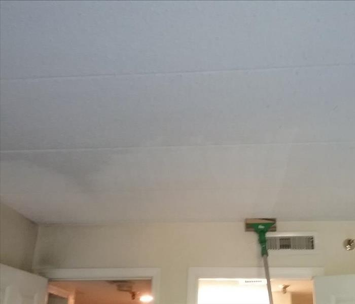 Cleaning a ceiling affected by a fire