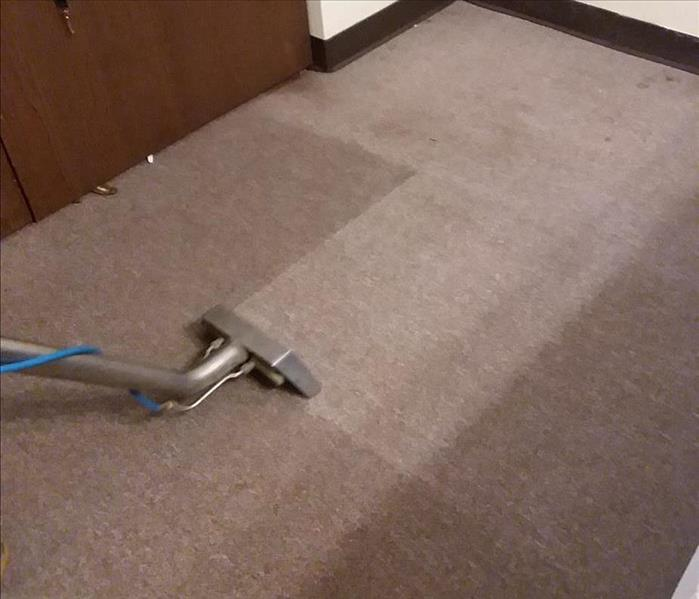 Extracting water from the carpet